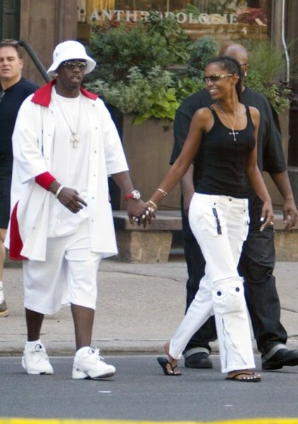 NEW YORK - JULY 25:  (***EXCLUSIVE***)  Sean (P.Diddy) Combs (L) and his girlfriend Kim Porter walk in the SoHo neighborhood of Manhattan July 25, 2003 in New York City.  (Photo by Mark Mainz/Getty Images)