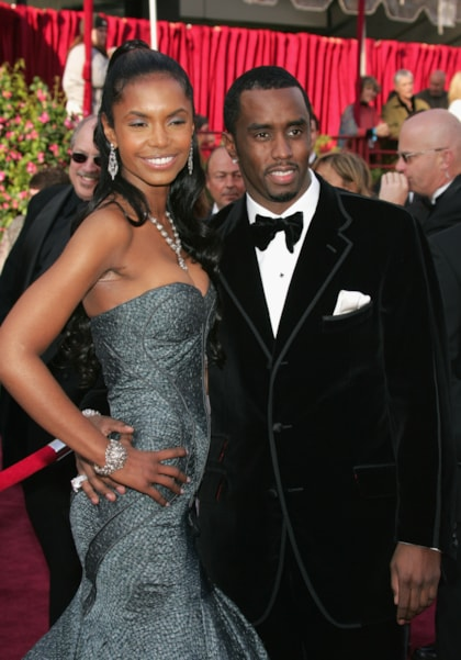"""HOLLYWOOD, CA - FEBRUARY 27:  Rapper Sean """"P Diddy"""" Combs (R) and Kim Porter arrive at the 77th Annual Academy Awards at the Kodak Theater on February 27, 2005 in Hollywood, California. (Photo by Carlo Allegri/Getty Images)"""