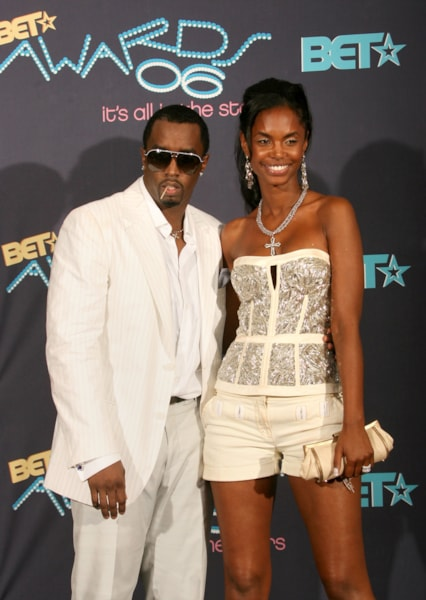 LOS ANGELES, CA - JUNE 27:  Rapper/Producer Sean 'P. Diddy' Combs (R) and girlfriend, model Kim Porter pose in the press room at the 2006 BET Awards at the Shrine Auditorium on June 27, 2006 in Los Angeles, California.  (Photo by Frederick M. Brown/Getty Images)