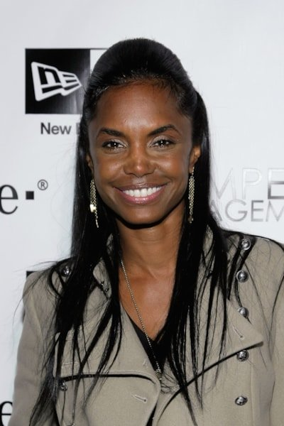 """HOLLYWOOD - DECEMBER 08:  Kim Porter attends the Famous Stars and Straps 10th Anniversary and Snoop Dogg's 10th album release """"Malice N Wonderland"""" party at Vanguard on December 8, 2009 in Hollywood, California.  (Photo by Noel Vasquez/Getty Images)"""