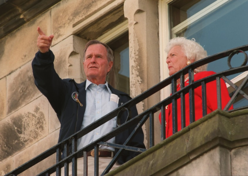 21 JUL 1995:  FORMER PRESIDENT OF THE UNITED STATES GEORGE BUSH WITH HIS WIFE BARBARA WATCH THE GOLF FROM THE OLD CLUBHOUSE DURING THE SECOND ROUND OF THE 1995 OPEN GOLF CHAMPIONSHIPS ON THE OLD COURSE AT ST. ANDREWS, FIFE, SCOTLAND.  Mandatory Credit:Steve Munday/ALLSPORT