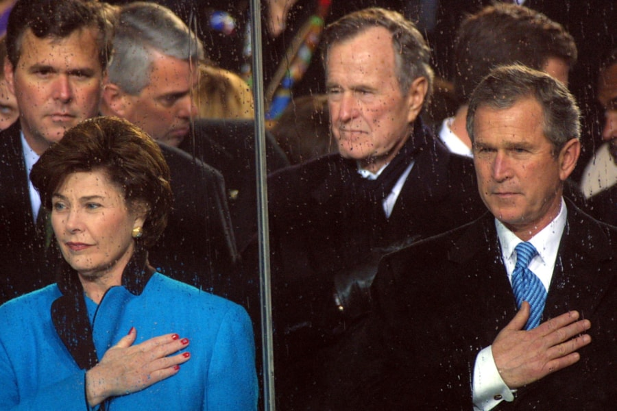 384549 02: Clockwise from upper right, former president George Bush, President George W. Bush and First Lady Laura Bush put their hands over their hearts as President Bush''s brother Florida Governor Jeb Bush looks on during the Inaugural Parade January 20, 2001, in Washington, DC. (Photo by Alex Wong/Newsmakers)