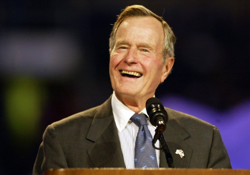 IRVING, TX - OCTOBER 17:  Former United States President George Bush speaks during the Billy Graham Crusade at Texas Stadium  October 17, 2002 in Irving, Texas. (Photo by Ronald Martinez/Getty Images)