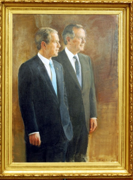 COLLEGE STATION, TX -  APRIL 21:  A portrait of former U.S. President George H.W. Bush (R) and current President George W. Bush is on display at the George Bush Library April 21, 2003 in College Station, Texas.  (Photo by Joe Mitchell/Getty Images)