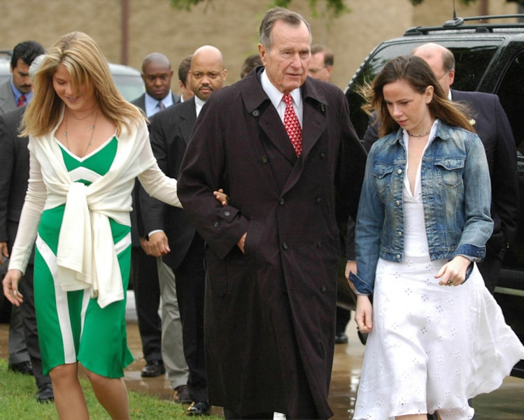 FT. HOOD, TX - APRIL 11:  Former President George Bush Sr arrives with his twin granddaughters Jenna (L) and Barbara for Easter services on Fort Hood Texas Sunday April 11, 2004.  (Photo by Rod Aydelotte-Pool/Getty Images)