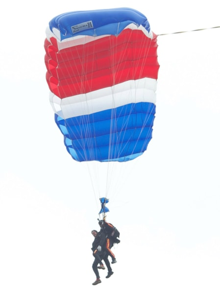 KENNEBUNKPORT, ME - JUNE 12:  (EDITORS NOTE: Retransmission with alternate crop.) Former U.S. President George H.W. Bush and Mike Elliott, US Army Sergeant 1st Class (ret), jump out of a helicopter and parachutes down to St. Anne's Episcopal Church on June 12, 2014 in Kennebunkport, Maine. The President is celebrating his 90th birthday today.   (Photo by Eric Shea/Getty Images)