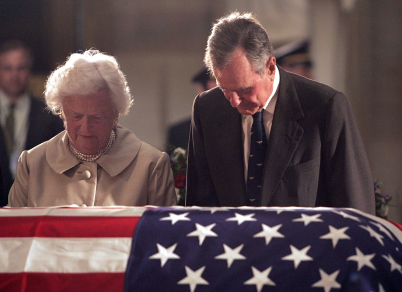 WASHINGTON - JUNE 10:  Former U.S. President George H.W. Bush and his wife, Barbara Bush, pay their respects to former U.S. President Ronald Reagan in the U.S. Capitol Rotunda June 10, 2004 in Washington, DC. Reagan's body will lie in state until his funeral at the National Cathederal June 11 in Washington, DC.  (Photo by Brendan Smialowski/Getty Images)