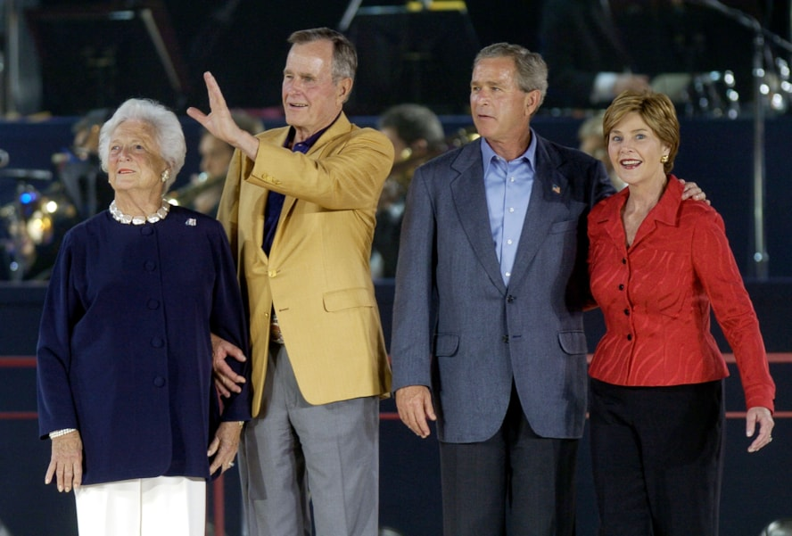 HOUSTON - JUNE 12:  Former President George H.W. Bush (2nd-L) and former first lady Barbara Bush (L) stand with their son, US President George W. Bush, and First Lady Laura Bush (R) as they are introduced at the opening of the elder Bush's 80th birthday celebration Saturday, June 12, 2004, in Houston, Texas. Bush senior plans on going skydiving on July 13 to celebrate. (Photo by Brett Coomer/Getty Images)