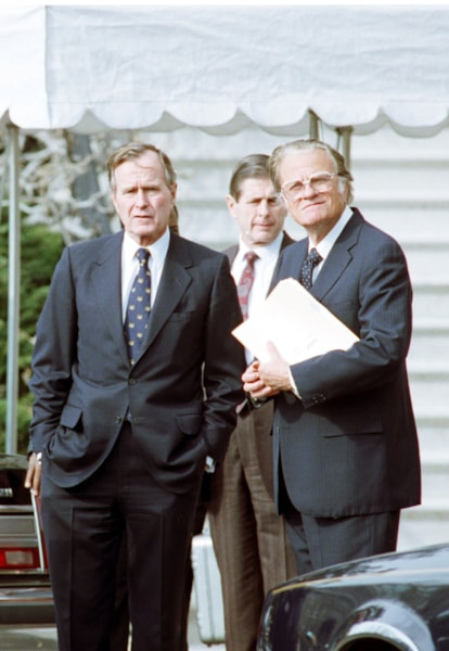 """87959_01: President George Bush Stands With Billy Graham January 19, 1991 At The White House Shortly After Graham Made A Speech In Washington, Dc. Graham Declared That The Present War In The Gulf Is A """"Fight For Peace"""" Which Will Result In """"A New World Order"""" As Suggested By President Bush.  (Photo By Getty Images)"""