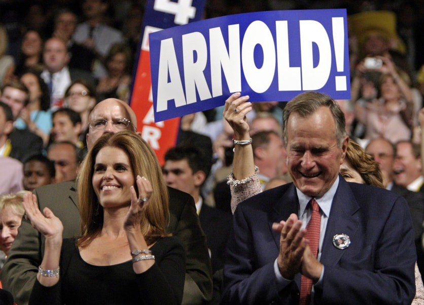 NEW YORK - AUGUST 31:  (L to R) Maria Shriver and former President George H.W. Bush applaud from the audience on night two of the Republican National Convention August 31, 2004 at Madison Square Garden in New York City.  (Photo by Shaun Heasley/Getty Images)