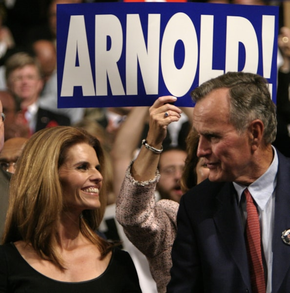 NEW YORK - AUGUST 31:  Former U.S. President George H.W. Bush (R) and Maria Shriver cheer California Governor Arnold Schwarzenegger from the audience on night two of the Republican National Convention August 31, 2004 at Madison Square Garden in New York City.  (Photo by Shaun Heasley/Getty Images)