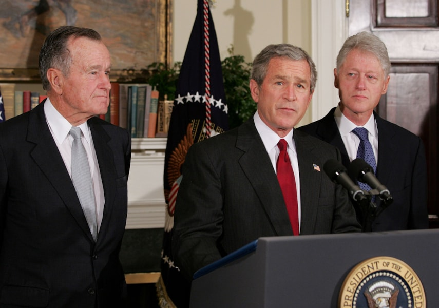WASHINGTON - JANUARY 3:  U.S. President George W. Bush (C) speaks as former U.S. President Bill Clinton (R) and former U.S. President George H.W. Bush listen during a news conference in the Roosevelt Room in the White House Monday January 3, 2005 in Washington, DC. Bush announced that Clinton and former U.S. President George H.W. Bush would lead a fundraising efforts for countries affected by the Tsunami. The three will also visit embassies of affected countries to pay condolances.  (Photo by Shawn Thew-Pool/Getty Images)