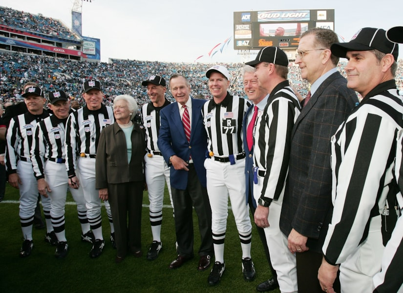 JACKSONVILLE, FL - FEBRUARY 6:  First Lady Barbara Bush, President Geroge H. Bush, President Bill Clinton and NFL Commissioner Paul Tagliabue pose with NFL referees on the field before the start of Super Bowl XXXIX between the New England Patriots and the Philadelphia Eagles at Alltel Stadium on February 6, 2005 in Jacksonville, Florida.  (Photo by Jed Jacobsohn/Getty Images)