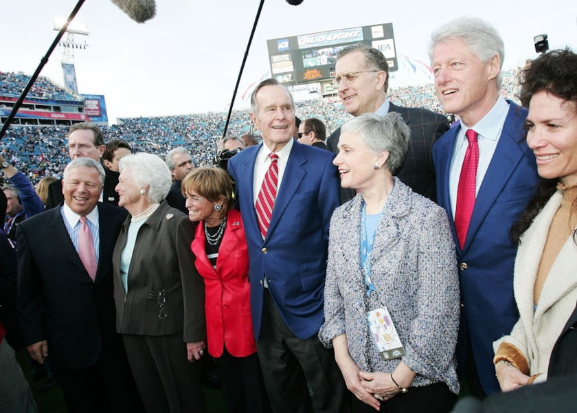 JACKSONVILLE, FL - FEBRUARY 06:  (L-R) New England Patriots owner Robert Kraft, First Lady Barbara Bush, President Geroge H. Bush, President Bill Clinton and NFL Commissioner Paul Tagliabue pose with NFL referees on the field before the start of Super Bowl XXXIX between the New England Patriots and the Philadelphia Eagles at Alltel Stadium on February 6, 2005 in Jacksonville, Florida.  (Photo by Jed Jacobsohn/Getty Images)