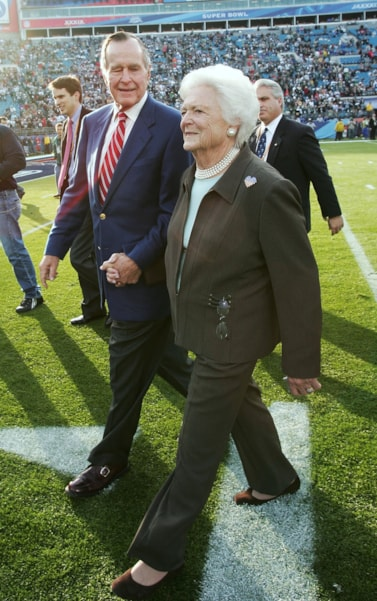 JACKSONVILLE, FL - FEBRUARY 06:  President Geroge H. Bush and First Lady Barbara Bush walk on the field before the start of Super Bowl XXXIX between the New England Patriots and the Philadelphia Eagles at Alltel Stadium on February 6, 2005 in Jacksonville, Florida.  (Photo by Jed Jacobsohn/Getty Images)