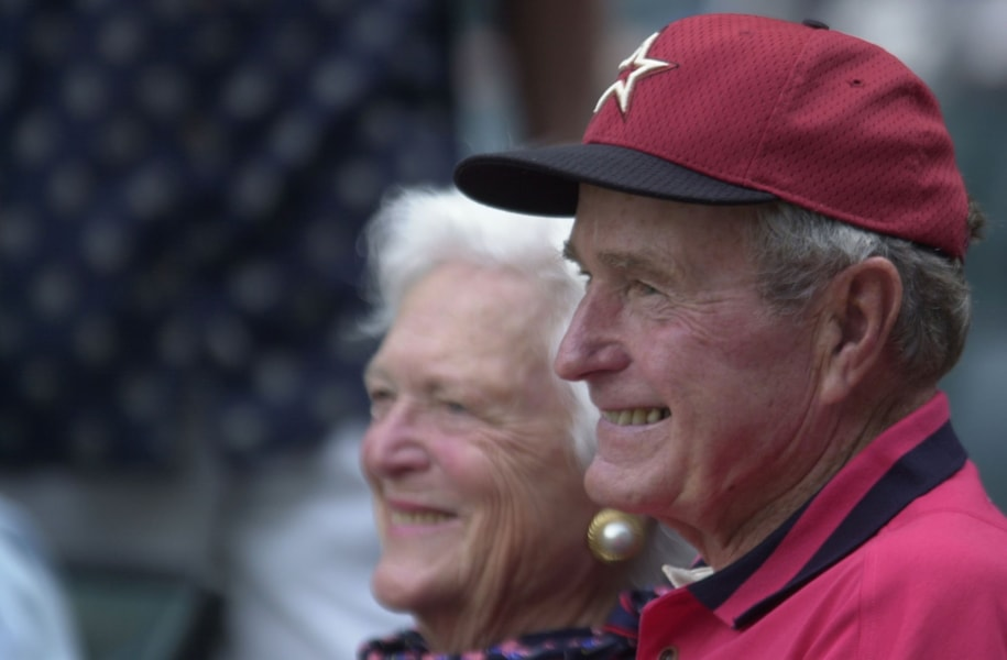 9 Oct 2001: Former President George Bush and his wife Barbara watch as the Astros take on the Atlanta Braves during game one of the National League Divisional Series at Enron Field in Houston, Texas. The Atlanta Braves beat the Houston Astros 7-4. DIGITAL IMAGE. Mandatory Credit: Elsa/ALLSPORT