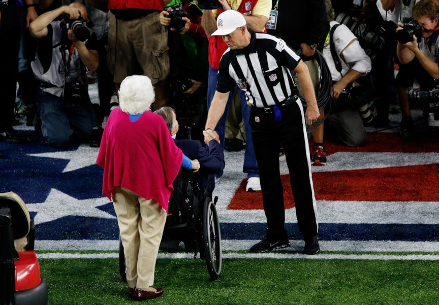 HOUSTON, TX - FEBRUARY 05:   Referee Carl Cheffers #51 shakes hands with President George H.W. Bush and Barbara Bush prior to Super Bowl 51 at NRG Stadium on February 5, 2017 in Houston, Texas.  (Photo by Bob Levey/Getty Images)