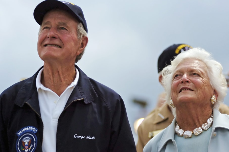 NEWPORT NEWS, VA - JULY 8:  Former U.S. President George H. W. Bush and former first lady Barbara watch as the 700-ton island super structure of the newest aircraft carrier, the USS George H. W. Bush, is manuvered into place on the deck of ship during a ceremony at the Newport News Shipyard July 8, 2006 in Newport News, Virginia. The placing of the island on the flight desk was part of a ceremony for the carrier that is scheduled to be christened in October.  (Photo by Gary C. Knapp/Getty Images)