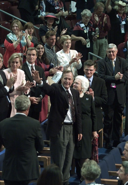 374754 20: ,George and Barbara Bush wave to the crowd as they arrive first day of the Republican National Convention, July 31, 2000 in Philadelphia. (Photo by Mark Wilson/Newsmakers)