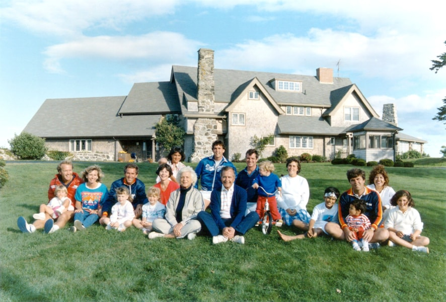 372407 01 :BUSH RETROSPECTIVE: Portrait of the Bush family in front of their Kennebunkport, Maine August 24, 1986. BACK ROW: Margaret holding daughter Marshall, Marvin Bush, Bill LeBlond. FRONT ROW: Neil Bush holding son Pierce, Sharon, George W. Bush holding daughter Barbara, Laura Bush holding daughter Jenna, Barbara Bush, George Bush, Sam LeBlond, Doro Bush Lebond, George P.(jeb's son), Jeb Bush holding son Jebby, Columba Bush, and Noelle Bush. (Photo by Newsmakers