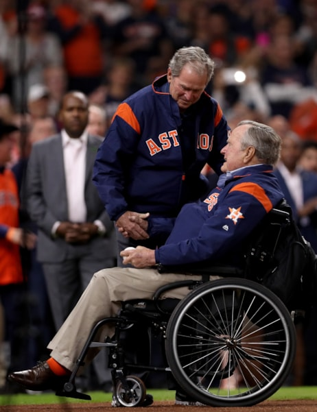 HOUSTON, TX - OCTOBER 29: Former United States Presidents George H.W. Bush and George W. Bush prepare to throw out the ceremonial first pitch before in game five of the 2017 World Series at Minute Maid Park on October 29, 2017 in Houston, Texas.  (Photo by Christian Petersen/Getty Images)