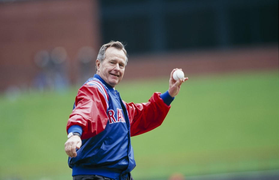 ARLINGTON, TX - APRIL 3:  George H.W. Bush throws out the first pitch before the Texas Rangers Opening Day game against the Chicago White Sox at The Ballpark in Arlington on April 3, 2000 in Arlington, Texas. (Photo by Ronald Martinez/Getty Images)