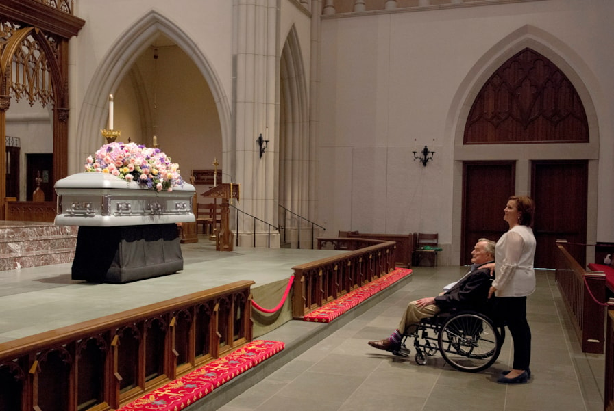 """HOUSTON, TX - APRIL 20:  In this handout provided by the Office of George H.W. Bush, former President George H. W. Bush looks at the casket with his daughter Dorothy """"Doro"""" Bush Koch as they wait for the mourners during the visitation of former first lady Barbara Bush at St. Martin's Episcopal Church Friday, April 20, 2018, in Houston, Texas. Barbara Bush died on April 17, at the age of 92. (Photo by Mark Burns - Pool/Office of George H.W. Bush via Getty Images)"""