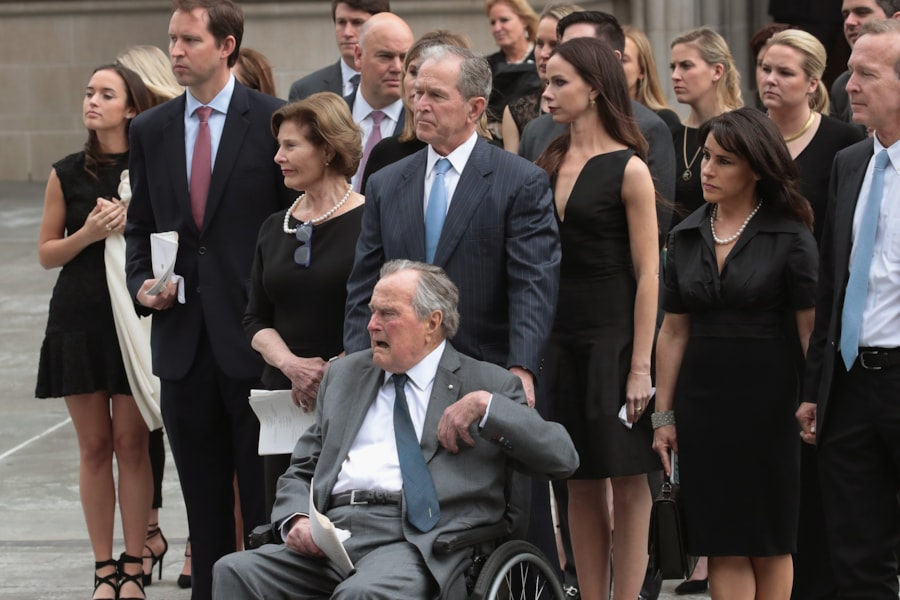 HOUSTON, TX - APRIL 21: Former president George H.W. Bush and son, former president George W. Bush, watch with family as the coffin of former first lady Barbara Bush is placed in a hearse outside of St. Martin's Episcopal Church following her funeral service on April 21, 2018 in Houston, Texas. Bush, wife of former president George H. W. Bush and mother of former president George W. Bush, died at her home in Houston on April 17 at the age of 92.  (Photo by Scott Olson/Getty Images)