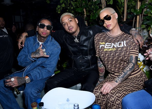 WEST HOLLYWOOD, CALIFORNIA - FEBRUARY 08: (L-R) Tyga, AE and Amber Rose attend the Def Jam Pre-Grammy 2019 party at Catch LA sponsored by Courvoisier, Puma, Klasse 14 and Tik Tok on February 08, 2019 in West Hollywood, California. (Photo by Presley Ann/Getty Images for Def Jam Recordings)
