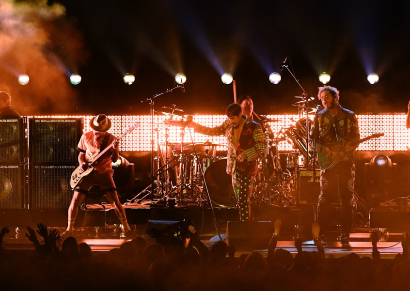 LOS ANGELES, CA - FEBRUARY 10:  (L-R) Flea, Anthony Kiedis, and Chad Smith of Red Hot Chili Peppers and Post Malone perform onstage during the 61st Annual GRAMMY Awards at Staples Center on February 10, 2019 in Los Angeles, California.  (Photo by Kevin Winter/Getty Images for The Recording Academy)